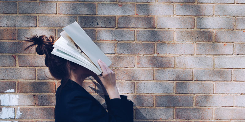 Student with their head in a book