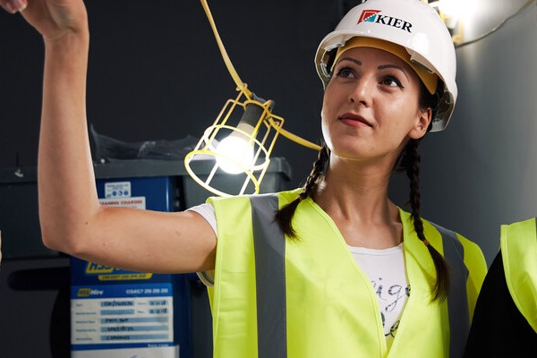 female civil engineering student at building site