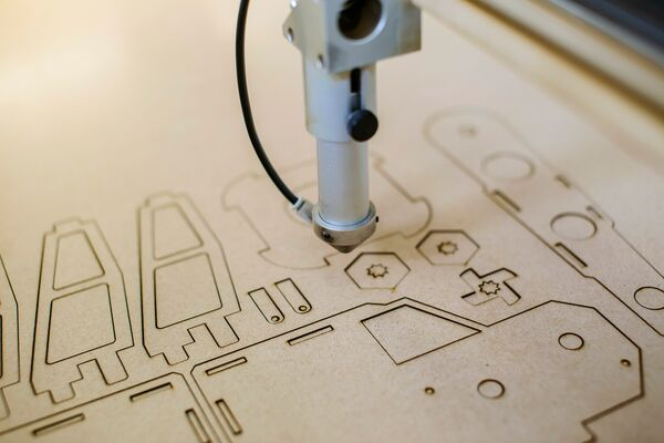 Laser cutting shapes in panel