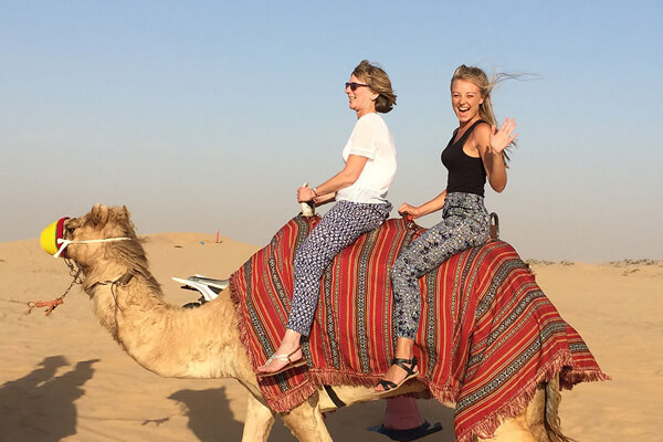 Abbi Mullan on a camel in a desert