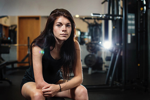 Para-Triathlete Lauren Steadman sitting in gym and facing camera