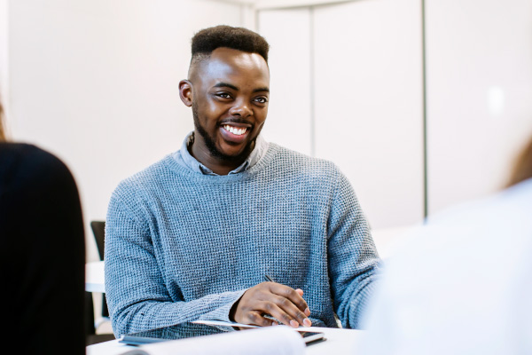 Degree apprenticeship student smiling in class