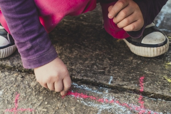 child during with chalk on the floor