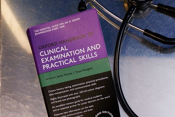 clinical health book and stethoscope