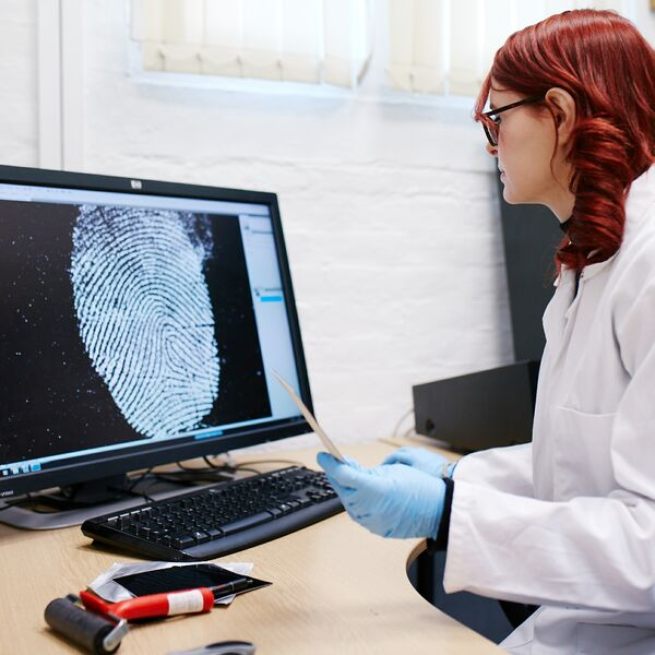 female researcher analysing fingerprint scan