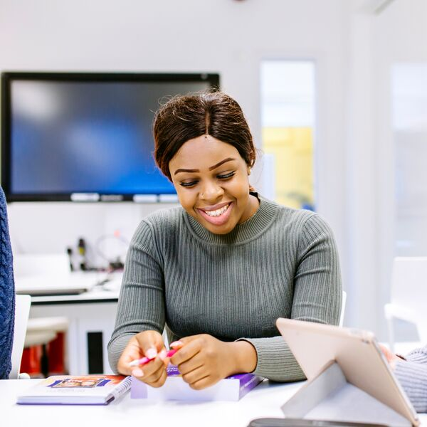 Female University of Portsmouth student smiling in classroom