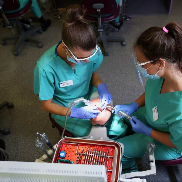two female students at dental academy