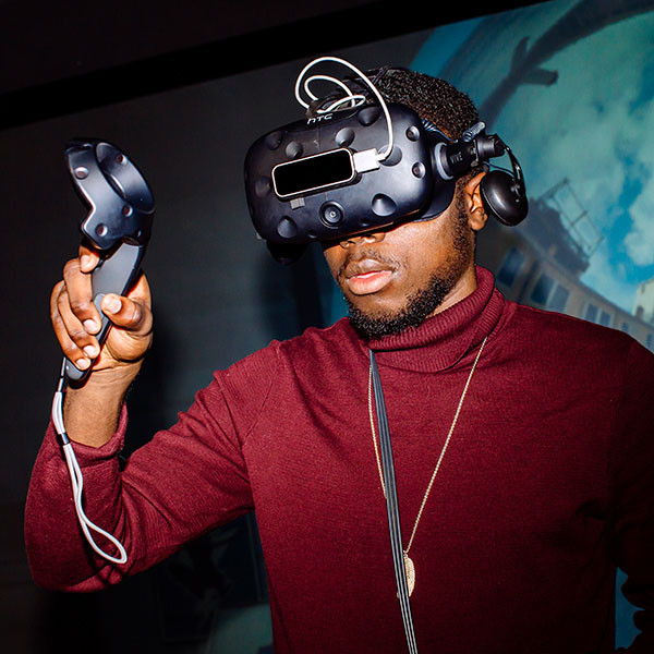 A student using a HTC Vive VR headset and controller