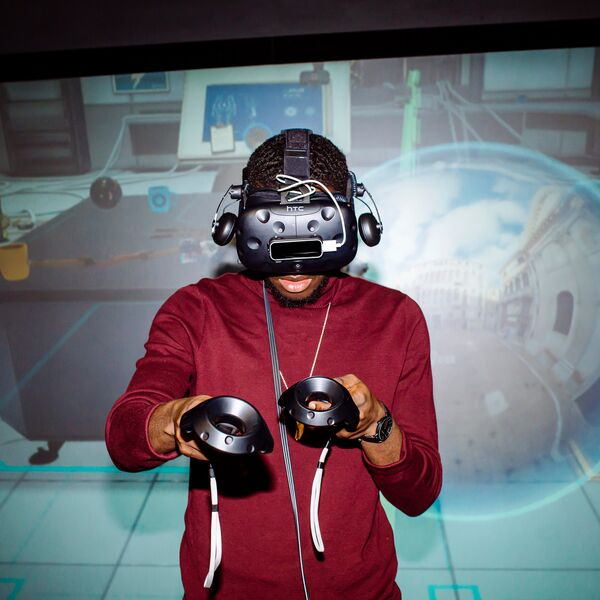 Male student uses virtual reality