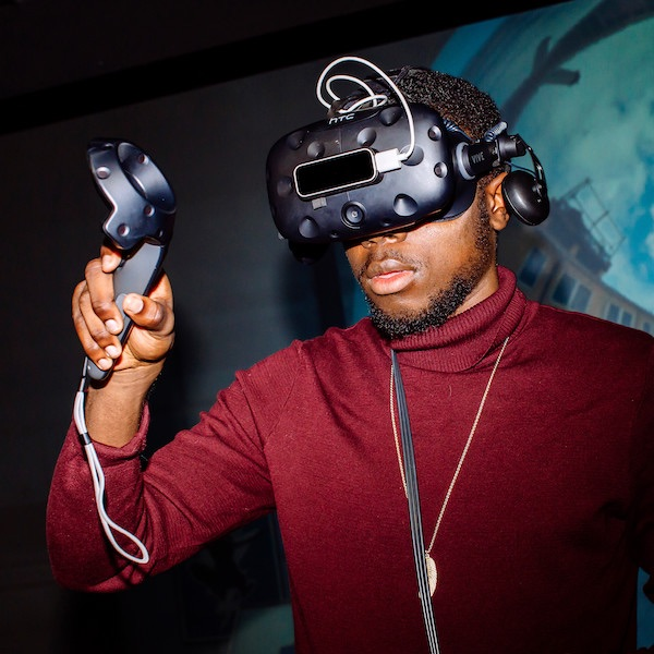 A male student using a VR headset
