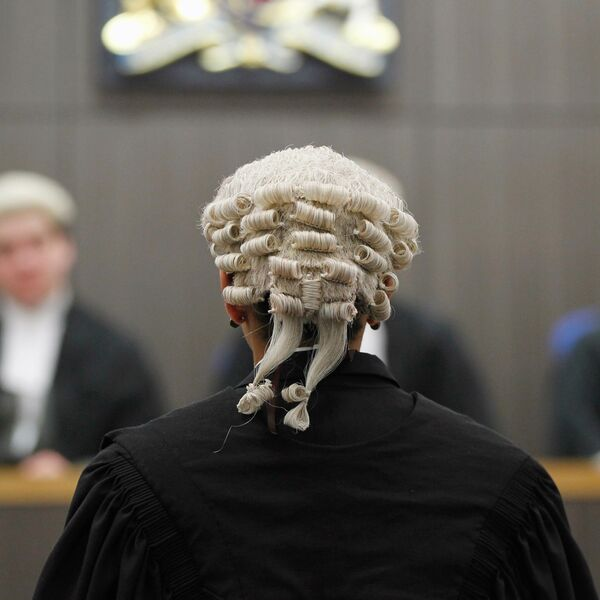 A student sat in a mock law court in legal dress