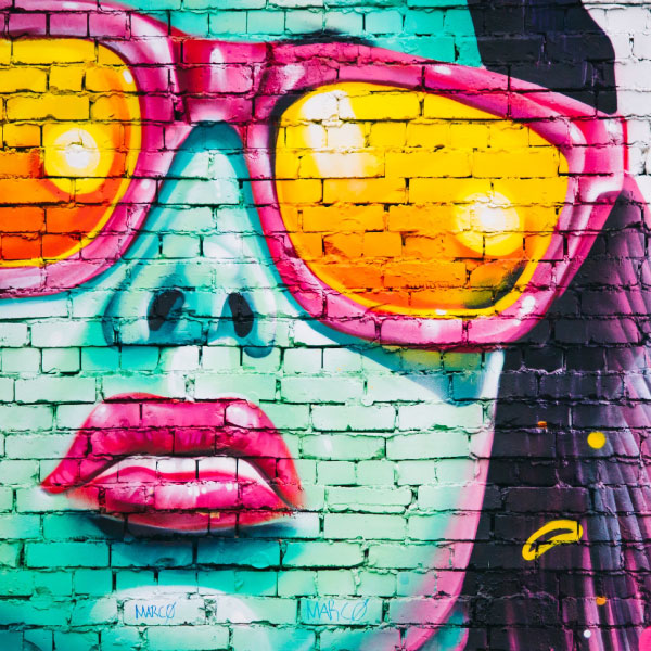 Street art image of woman in sunglasses