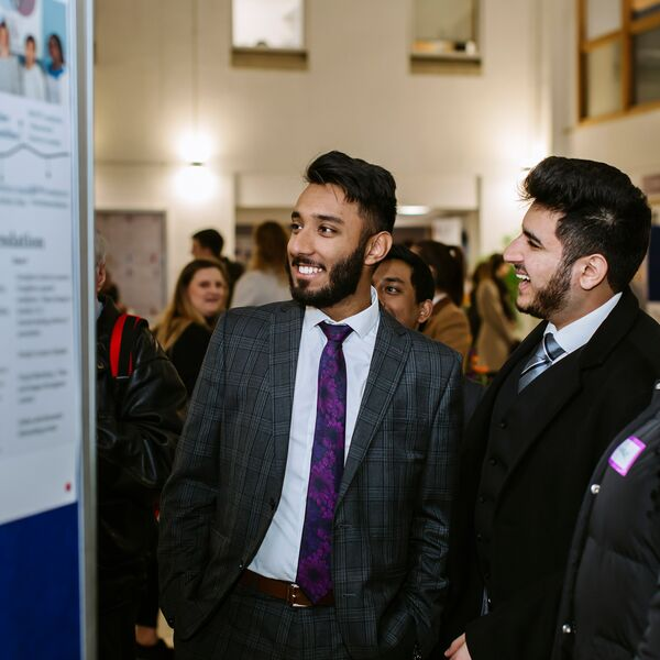 Male business students at networking event