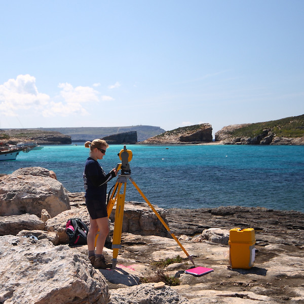 female student carrying out survey of Maltese coast