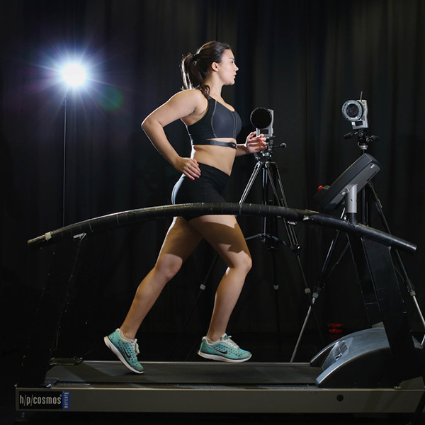 Female runner on treadmill with motion capture cameras