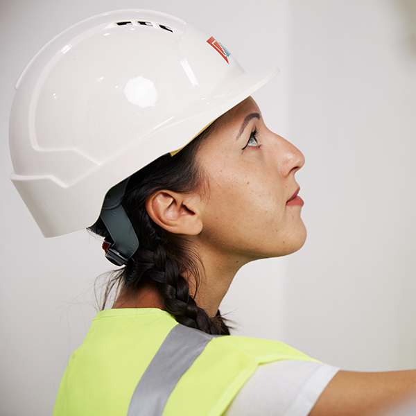 Female wearing hard hat and reflective jacket