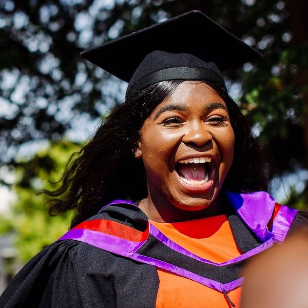 Female student smiling on graduation day