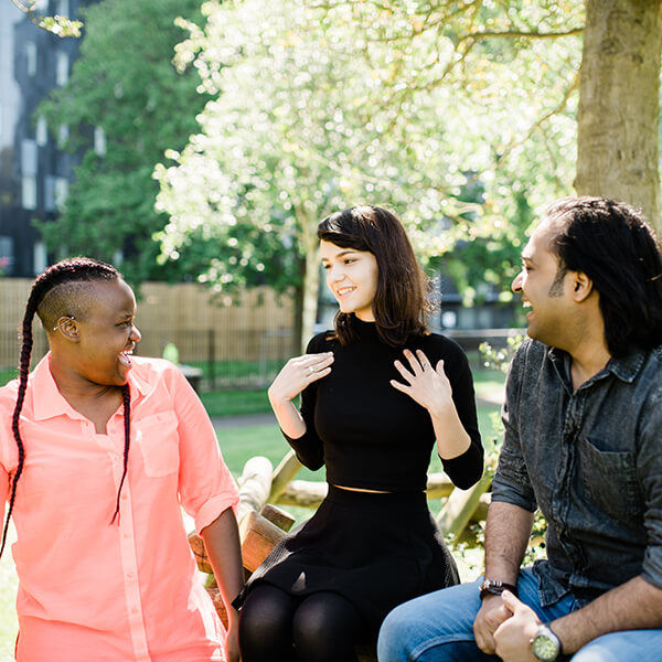 Students chatting in park