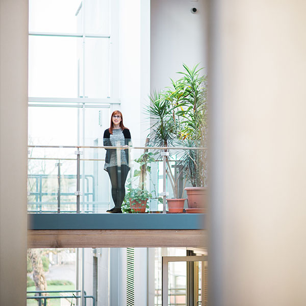 Student standing on balcony in University of Portsmouth Library