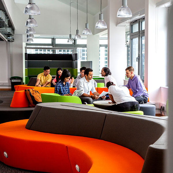 People in colourful seating pods in Faculty of Technology, Portsmouth