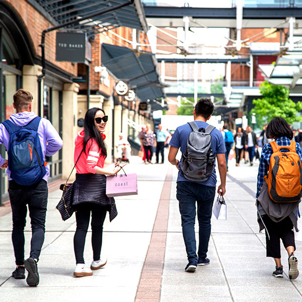 students shopping in Gun Wharf Quays