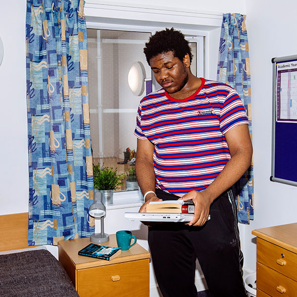 Student in bedroom in Harry Law Hall, Portsmouth