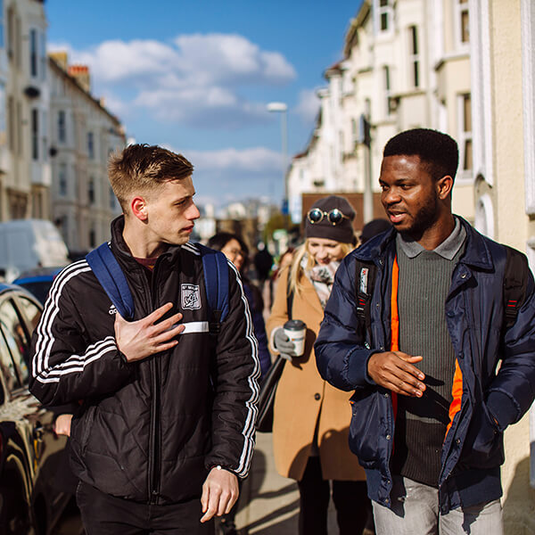 University students talking and walking in Southsea