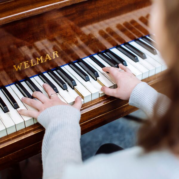 Female student playing piano