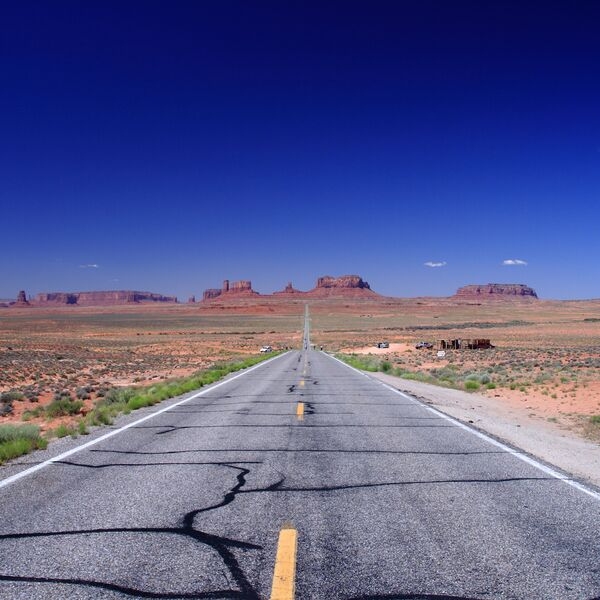 Road leading away from viewer in Monument Valley