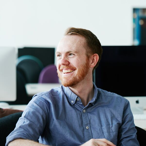 Male researcher at University of Portsmouth, smiling