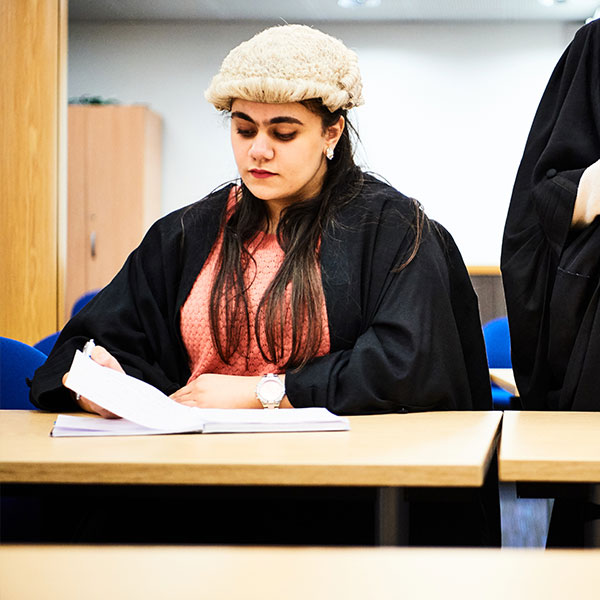 Law student in mock courtroom