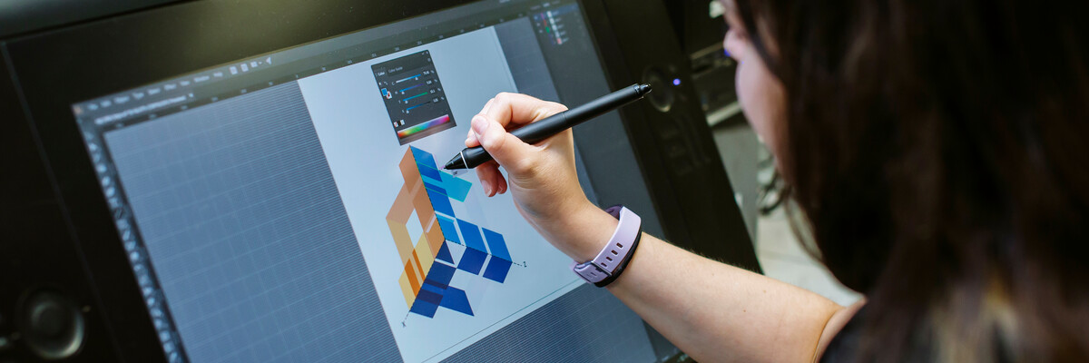 woman drawing design on wacom software