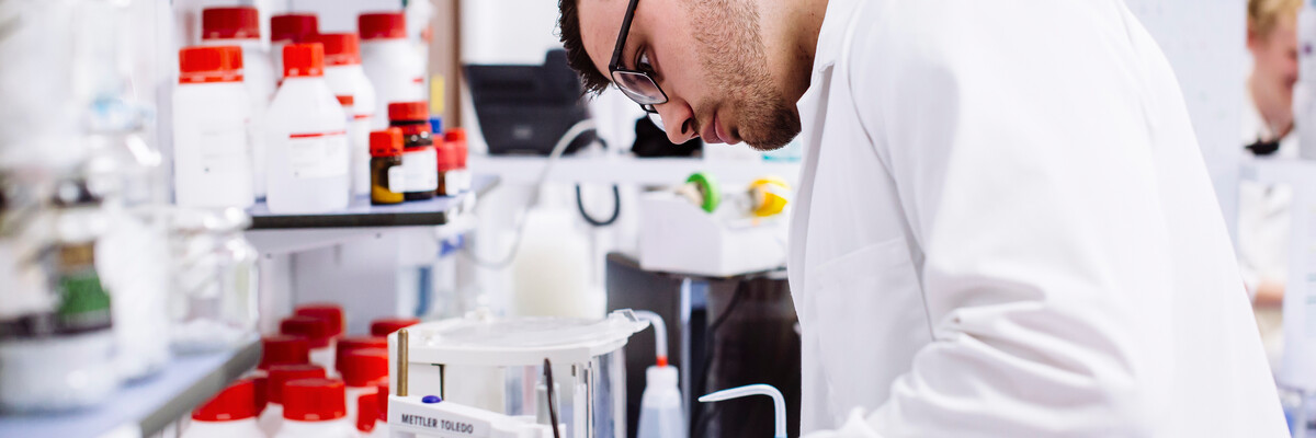 Male student working in a biology lab