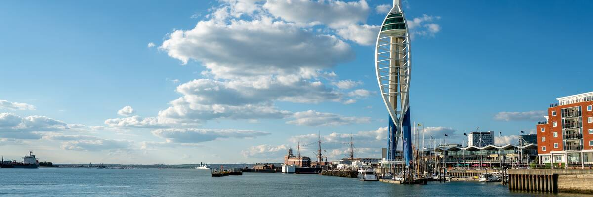 Wide view of the sea and Spinnaker Tower on a sunny day.