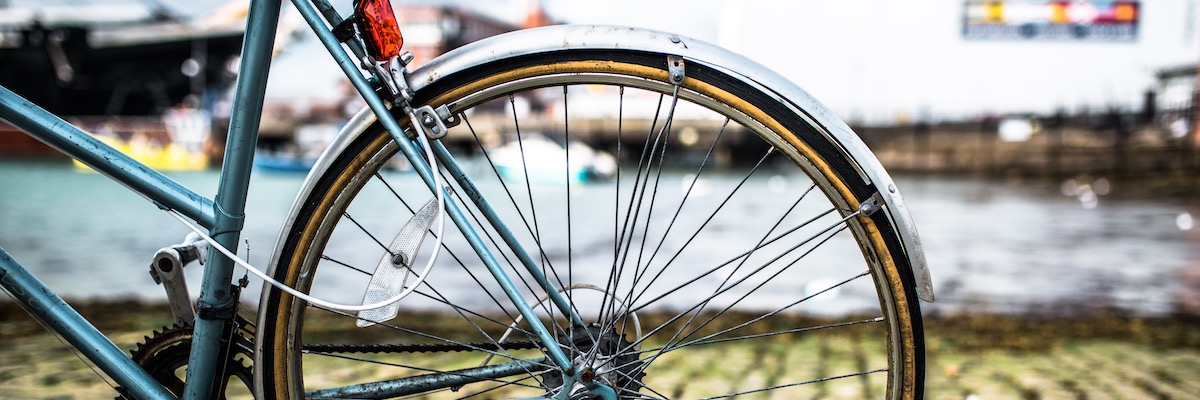 Close-up of bicycle wheel at historic dockyard, Portsmouth