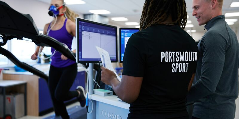 Female sports participant running in research lab