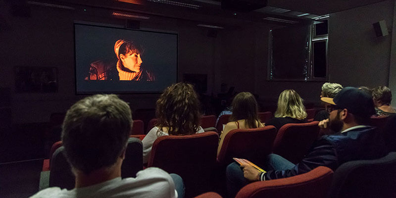 students watching a film in screen lecture theatre