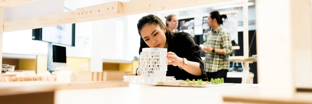 Female student holding architecture model