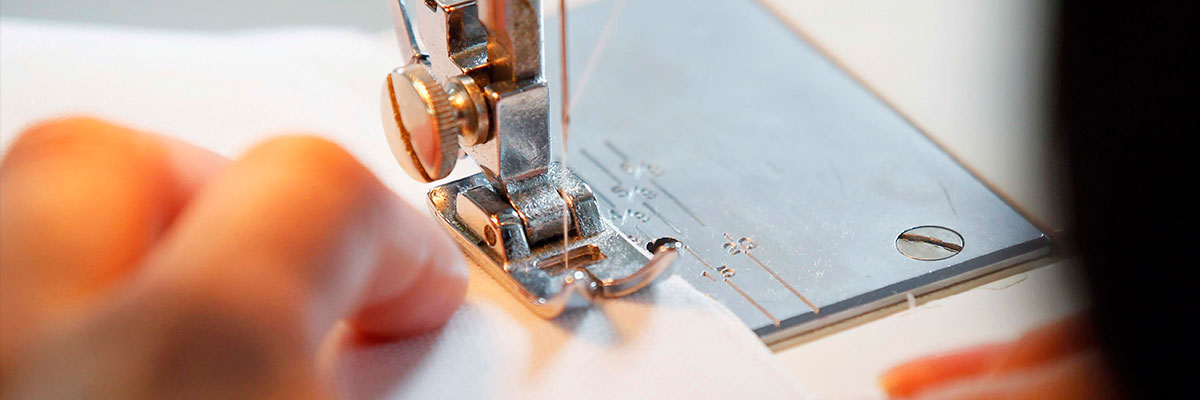 Fashion and textile student uses sewing machine