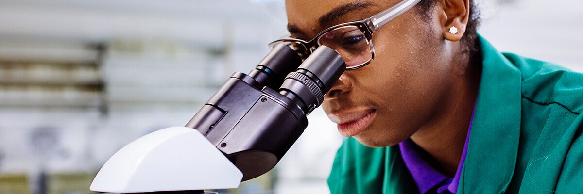 Medical Biotechnology student uses microscope