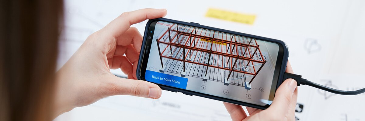 Quantity surveying student views augmented reality model of the structure of a building