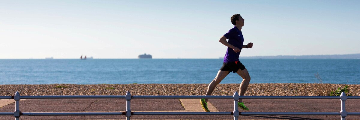 Man running along the seafront