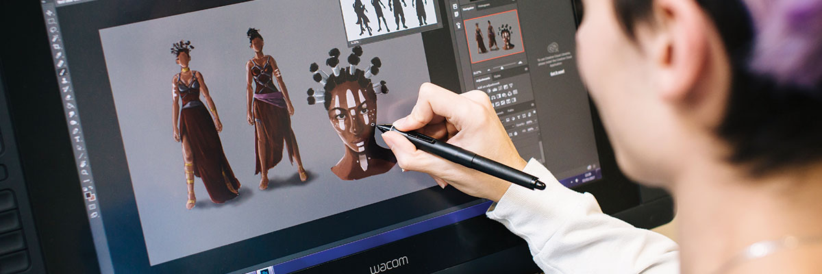 Student illustrating on a Wacom tablet screen
