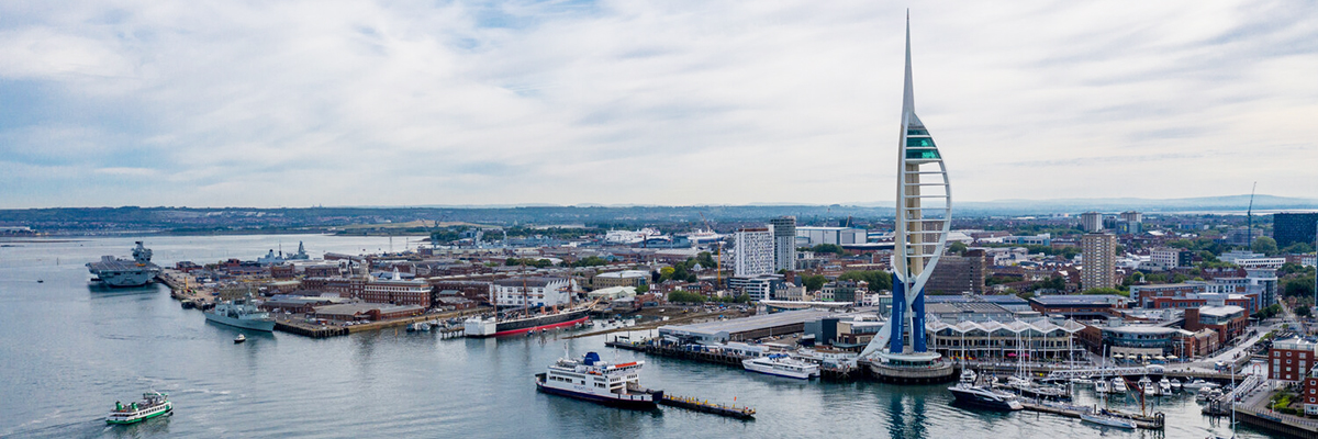 A landscape view of Portsmouth Dockyards and Spinnaker