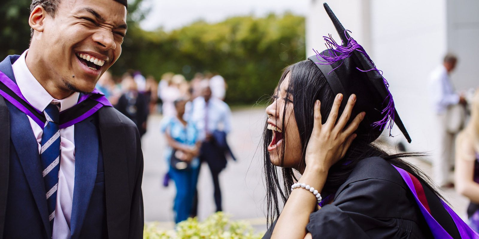 Male and female student celebrating graduation