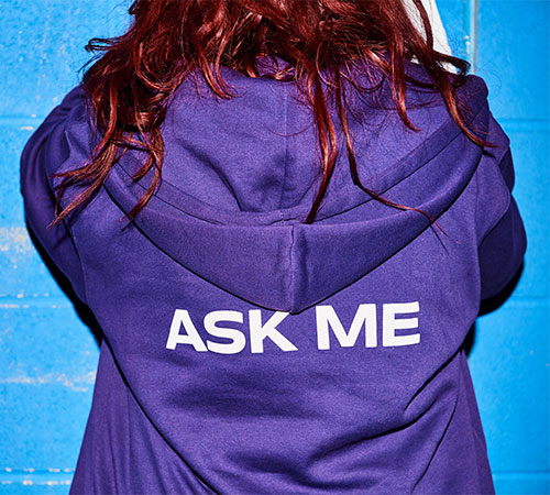Student ambassador with 'Ask Me' hoodie