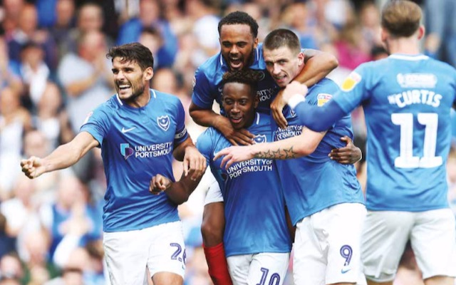 Portsmouth Football Club players celebrate a goal at Fratton Park