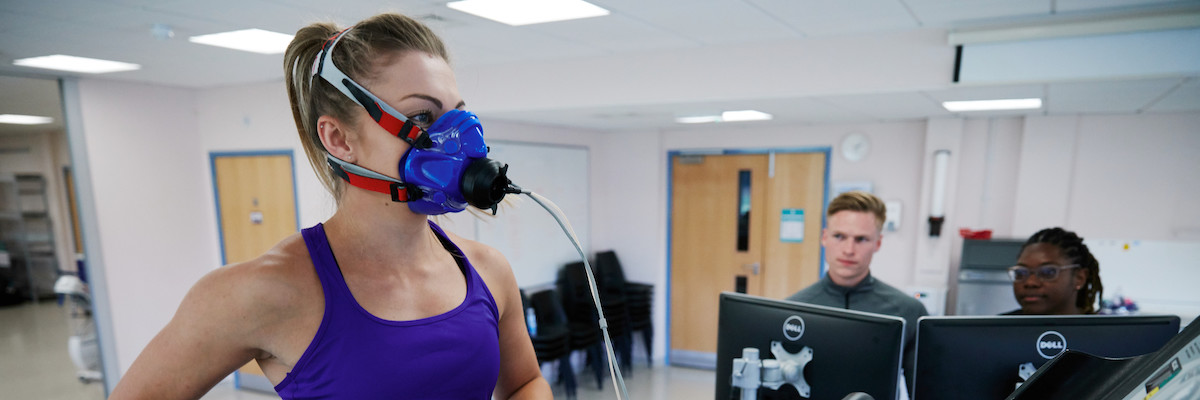 female research participant in running mask