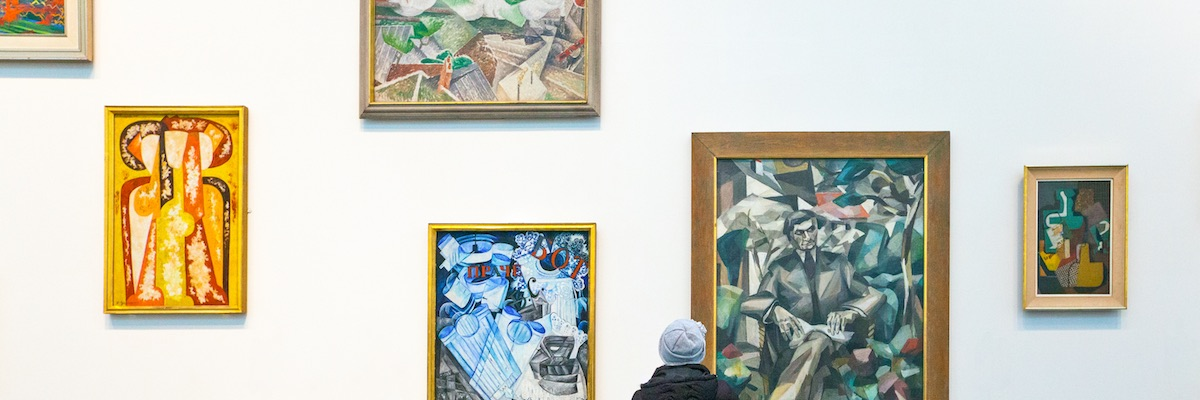 Visitor looking at artworks on the wall at Tate Modern, London