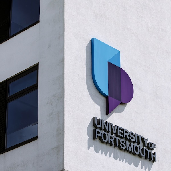 corner of University of Portsmouth building with logo